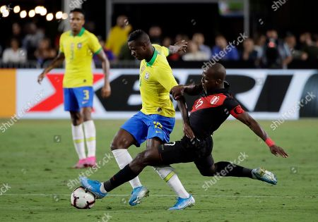 Vinicius Jr., Luis Advincula. Brazil's Vinicius Jr. is defended by Peru's Luis Advincula during the second half of an international friendly soccer match, in Los Angeles