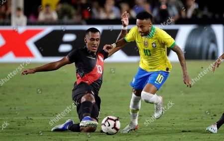 Neymar Jr., Renato Tapia. Brazil's Neymar Jr. right, is defended by Peru's Renato Tapia during the second half of an international friendly soccer match, in Los Angeles