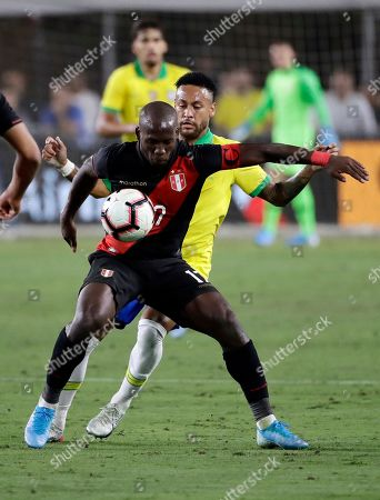 Luis Advincula, Neymar Jr. Peru's Luis Advincula, front, controls the ball in front of Brazil's Neymar Jr. during the second half of an international friendly soccer match, in Los Angeles