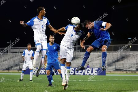 Sidney Rivera (C) and Marc Nieves (L) of Puerto Rico in action against Carlos Gallardo (R) of Guatemala during a Concacaf Nations League match between Puerto Rico and Guatemala in Mayaguez, Puerto Rico, 10 September 2019