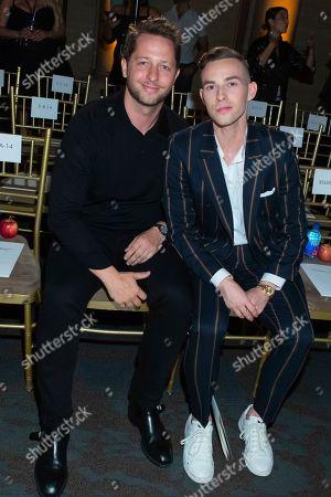 Derek Blasberg, Adam Rippon. Derek Blasberg, left, and Adam Rippon attend the Oscar de la Renta runway show during NYFW Spring/Summer 2020, in New York