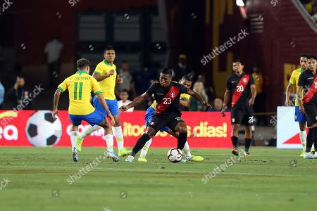 Pedro Aquino (C-L) of Peru in action against David Neres (C-R) of Brazil during a friendly soccer match between Brazil and Peru at the Los Angeles Memorial Coliseum in Los Angeles, California, USA, 10 September 2019.