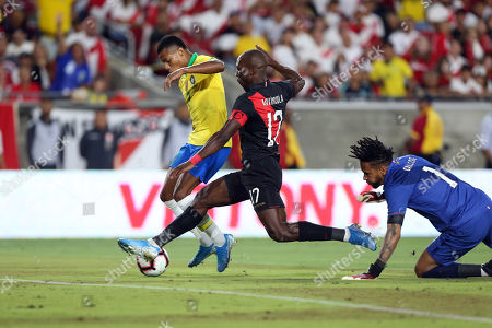 David Neres (L) of Brazil in action against Luis Advincula (C) of Peru during a friendly soccer match between Brazil and Peru at the Los Angeles Memorial Coliseum in Los Angeles, California, USA, 10 September 2019.