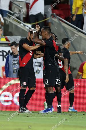 Luis Abram (L) of Peru gets congratulated by teammate Renato Tapia (R) during a friendly soccer match between Brazil and Peru at the Los Angeles Memorial Coliseum in Los Angeles, California, USA, 10 September 2019.