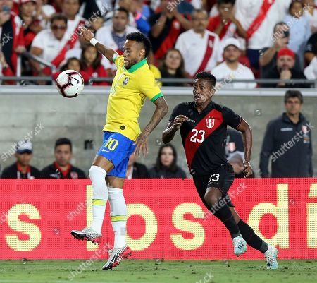 Neymar Jr. (L) of Brazil in action against Pedro Aquino (R) of Peru during a friendly soccer match between Brazil and Peru at the Los Angeles Memorial Coliseum in Los Angeles, California, USA, 10 September 2019.