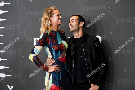 Toni Garrn, Mohammed Al Turki. Toni Garrn, left, and Mohammed Al Turki attend the Spring/Summer 2020 Savage X Fenty show, presented by Amazon Prime, at the Barclays Center on Tuesday, Sept, 10, 2019, in New York