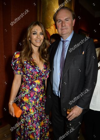 Stock Picture of Elizabeth Hurley and William Cash