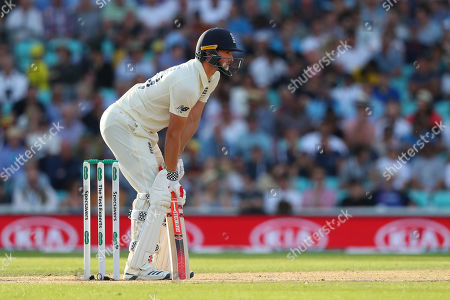 LONDON, ENGLAND. 14 SEPTEMBER 2019: Chris Woakes of England takes his guard during day three of the 5th Specsavers Ashes Test Match, at The Kia Oval Cricket Ground, London, England.