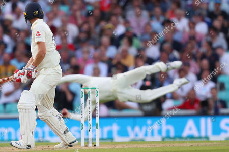 LONDON, ENGLAND. 14 SEPTEMBER 2019: Chris Woakes of England looks back to see Steve Smith of Australia take a catch to dismiss him during day three of the 5th Specsavers Ashes Test Match, at The Kia Oval Cricket Ground, London, England.