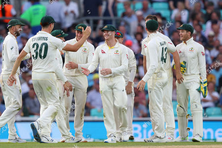 LONDON, ENGLAND. 14 SEPTEMBER 2019: Steve Smith of Australia celebrates taking a catch for the wicket of Chris Woakes of England during day three of the 5th Specsavers Ashes Test Match, at The Kia Oval Cricket Ground, London, England.