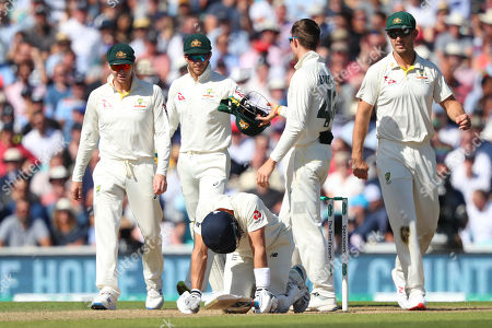 LONDON, ENGLAND. 14 SEPTEMBER 2019: Steve Smith, Tim Paine, Cameron Bancroft and Mitchell Marsh of Australia look on as Joe Denly of England is on all fours after being struck in the midriff during day three of the 5th Specsavers Ashes Test Match, at The Kia Oval Cricket Ground, London, England.