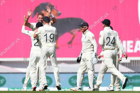 LONDON, ENGLAND. 15 SEPTEMBER 2019: Stuart Broad of England celebrates taking the wicket of David Warner of Australia during day four of the 5th Specsavers Ashes Test Match, at The Kia Oval Cricket Ground, London, England.
