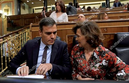 Spanish acting Prime Minister, Pedro Sanchez (L), chats with deputy Prime Minister, Carmen Calvo (R), during question time at the Lower House in Madrid, Spain, 11 September 2019. Sanchez will be appearing at Parliament to inform about the contents of the agreements achieved during the last European Union Councils held in June and July 2019 as well as to report the last novelties on Brexit.