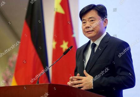 China's ambassador to Germany, Wu Ken, addresses the media during a press conference in Berlin, Germany