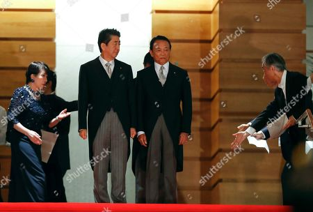 Japanese Prime Minister Shinzo Abe (2-L) and Finance Minister Taro Aso looking at attendants leading Internal Affairs and Communications Minister Sanae Takaichi (L) during a photo session at the Prime Minister's official residence in Tokyo, Japan, 11 September 2019 after reshuffling his cabinet.