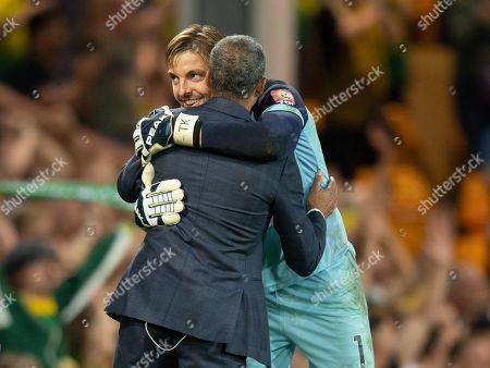 Norwich City Goalkeeper Tim Krul hugs former Manager Chris Hughton at full-time