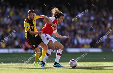 Matteo Guendouzi of Arsenal battles with Tom Cleverley of Watford
