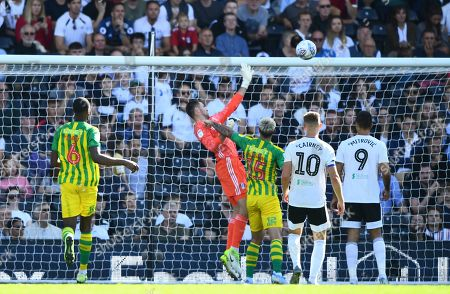 Goalkeeper Marcus Bettinelli of Fulham complains about a foul on him by Charlie Austin of West Bromwich Albion in the lead up to the equalising goal