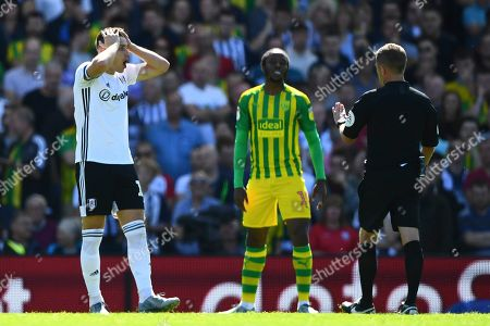 Tom Cairney of Fulham reacts towards David Webb after he felt his side should have had a corner