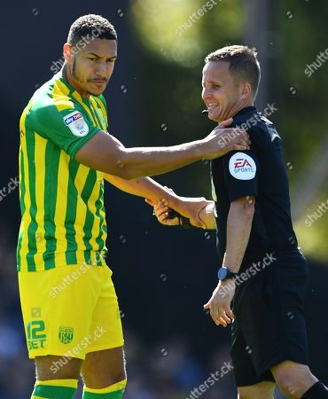 Jake Livermore of West Bromwich Albion with referee David Webb