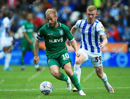 Barry Bannan of Sheffield Wednesday and Lewis O'Brien of Huddersfield Town