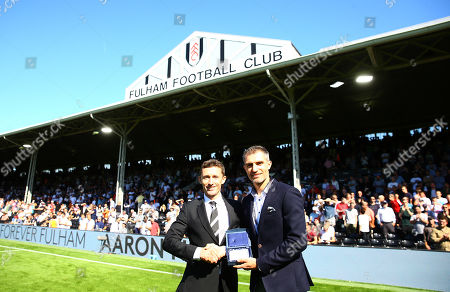 Aaron Hughes is presented with his Forever Fulham award by CEO Alistair Mackintosh at half time