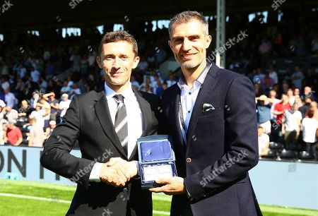 Stock Photo of Aaron Hughes is presented with his Forever Fulham award by CEO Alistair Mackintosh at half time