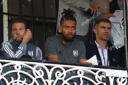 Stock Picture of The suspended Harry Arter of Fulham and new signing Michael Hector watch alongside Aaron Hughes in the Cottage