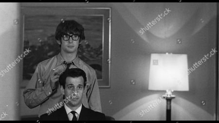 Stock Picture of Ian Hart as John Lennon and David Angus as Brian Epstein
