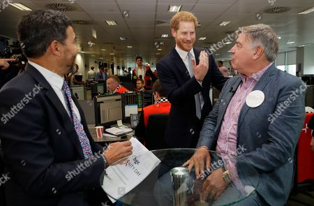 Prince Harry meets soccer manager Sam Allardyce, right, as he attends the 15th annual BGC Charity Day, in London, Wednesday, Sept. 11, 2019. The day is held each year by BGC Partners to commemorate the 658 Cantor Fitzgerald and the 61 EuroBrokers employees who lost their lives in the 9/11 attacks on the World Trade Centre.