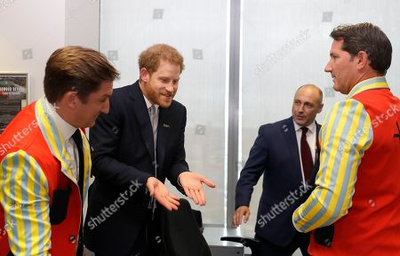 Prince Harry gestures as he attends the 15th annual BGC Charity Day