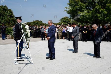 George W. Bush, Donald Rumsfeld, Mark Esper. Former President George W. Bush, center, pauses in front of Defense Secretary Mark Esper, second from back right, and former Defense Secretary Donald Rumsfeld, after placing a wreath on the grounds of the National 9/11 Pentagon Memorial at the Pentagon in Washington, in observance of the 18th anniversary of the September 11 attacks