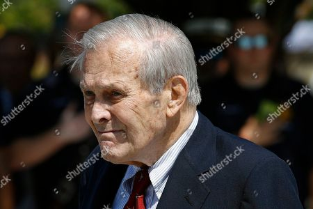 Former Defense Secretary Donald Rumsfeld attends a wreath laying ceremony with former President George W. Bush and Defense Secretary Mark Esper on the grounds of the National 9/11 Pentagon Memorial at the Pentagon in Washington, in observance of the 18th anniversary of the September 11th attacks