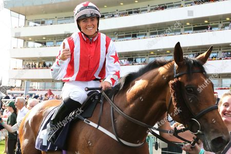 DUBAI ACCLAIM (4) ridden by Sammy Jo Bell and trained by Richard Fahey celebrates by giving a thumbs up after winning The Mondialiste Leger Legends Classified Stakes over 1m (£11,600)  during the opening day of the St Leger Festival at Doncaster Racecourse, Doncaster