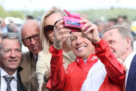 FRANKIE DETTORI takes a selfie with Michael Hills, George Duffield and Kevin Darley during the opening day of the St Leger Festival at Doncaster Racecourse, Doncaster