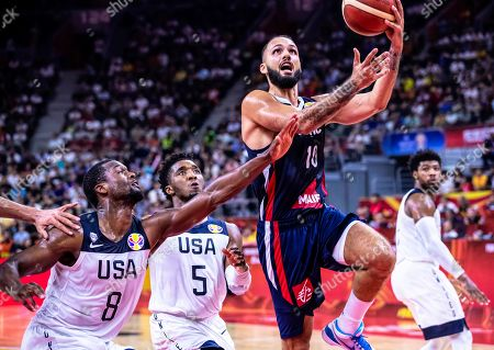 Evan Fournier (2-R) of France in action against US players Donovan Mitchell (C) and Harrison Barnes (L) during the FIBA Basketball World Cup 2019 quarter final match between the USA and France in Dongguan, China, 11 September 2019. France won 89-79.