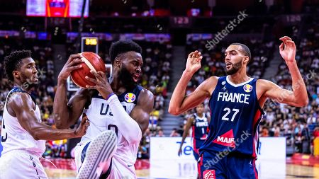 Rudy Gobert (R) of France in action against US players Jaylen Brown (C) and Donovan Mitchell (L) during the FIBA Basketball World Cup 2019 quarter final match between the USA and France in Dongguan, China, 11 September 2019. France won 89-79.