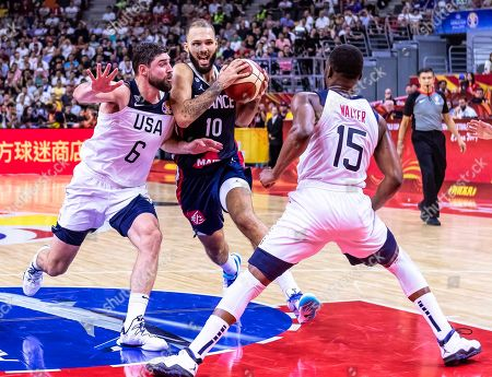 Evan Fournier (C) of France in action against US players Joe Harris (L) and Kemba Walker (R) during the FIBA Basketball World Cup 2019 quarter final match between the USA and France in Dongguan, China, 11 September 2019. France won 89-79.