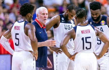 Stock Image of US head coach Gregg Popovich (2-L) gives instructions to his players during the FIBA Basketball World Cup 2019 quarter final match between the USA and France in Dongguan, China, 11 September 2019. France won 89-79.