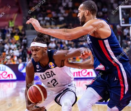 Myles Turner (L) of the USA in action against Rudy Gobert (R) of France during the FIBA Basketball World Cup 2019 quarter final match between the USA and France in Dongguan, China, 11 September 2019.