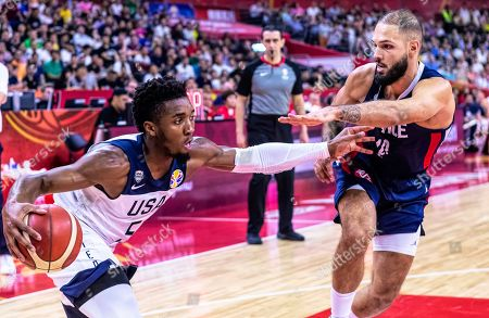 Donovan Mitchell (L) of the USA in action against Evan Fournier (R) of France during the FIBA Basketball World Cup 2019 quarter final match between the USA and France in Dongguan, China, 11 September 2019.