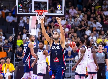 Nicolas Batum (C) of France celebrates after winning the FIBA Basketball World Cup 2019 quarter final match between the USA and France in Dongguan, China, 11 September 2019. France won 89-79.