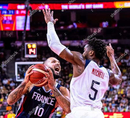 Evan Fournier (L) of France in action against Donovan Mitchell (R) of the USA during the FIBA Basketball World Cup 2019 quarter final match between the USA and France in Dongguan, China, 11 September 2019. France won 89-79.