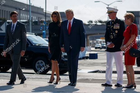 Donald Trump, Melania Trump, Joe Dunford, Ellyn Dunford. Secretary of Defense Mark Esper, left, and Chairman of the Joint Chiefs of Staff Gen. Joseph Dunford and his wife Ellyn look on as President Donald Trump and first lady Melania Trump arrive to participate in a ceremony honoring the victims of the Sept. 11 terrorist attacks, at the Pentagon