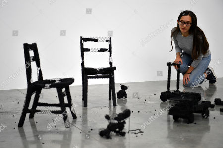 A gallery assistant poses with the artwork 'Remains of the Day (Play Space)' by Palestinian artist Mona Hatoum as part of a multi-artist show at the White Cube Bermondsey in Lon?don, Britain, 11 September 2019. The exhibition runs from 12 September to 03 November.