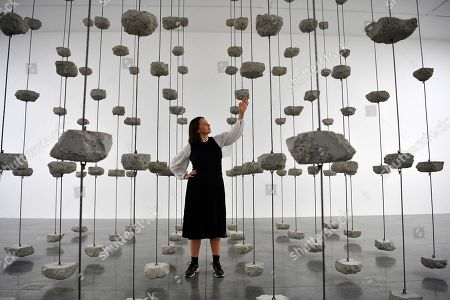 A gallery assistant poses with the artwork 'Remains to be Seen' by Palestinian artist Mona Hatoum as part of a multi-artist show at the White Cube Bermondsey in Lon?don, Britain, 11 September 2019. The exhibition runs from 12 September to 03 November.