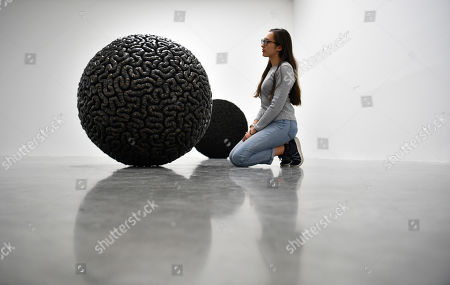 A gallery assistant poses with the artwork 'Dark Matter' by Palestinian artist Mona Hatoum as part of a multi-artist show at the White Cube Bermondsey in Lon?don, Britain, 11 September 2019. The exhibition runs from 12 September to 03 November.