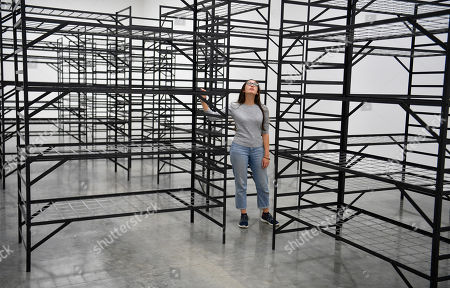 A gallery assistant poses with the artwork 'Quarters' by Palestinian artist Mona Hatoum as part of a multi-artist show at the White Cube Bermondsey in Lon?don, Britain, 11 September 2019. The exhibition runs from 12 September to 03 November.
