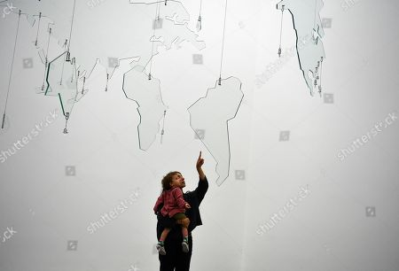 Visitors look at the artwork 'Map' by Palestinian artist Mona Hatoum as part of a multi-artist show at the White Cube Bermondsey in Lon?don, Britain, 11 September 2019. The exhibition runs from 12 September to 03 November.