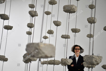 Palestinian artist Mona Hatoum poses with her artwork 'Remains to be Seen' as part of a multi-artist show at the White Cube Bermondsey in Lon?don, Britain, 11 September 2019. The exhibition runs from 12 September to 03 November.
